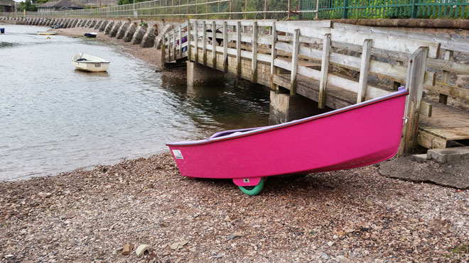 easyLAUNCH 9 Dinghy with its built in dinghy launching wheels resting on shingle slipway